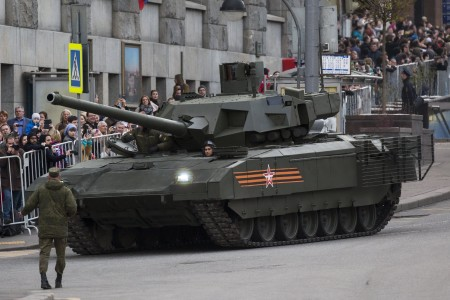 The new Russian T-14 Armata tank makes its way to Red Square during a rehearsal for the Victory Day military parade which will take place at Moscow's Red Square on May 9 to celebrate 70 years after the victory in WWII, in Moscow, Russia, Monday, May 4, 2015. Russia's new Armata tank has appeared in public for the first time, rumbling down a broad Moscow avenue on its way to Red Square for the Victory Day parade's final rehearsal. (AP Photo/Alexander Zemlianichenko)